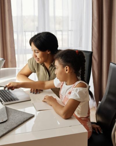 mother-helping-her-daughter-with-her-homework-4260323